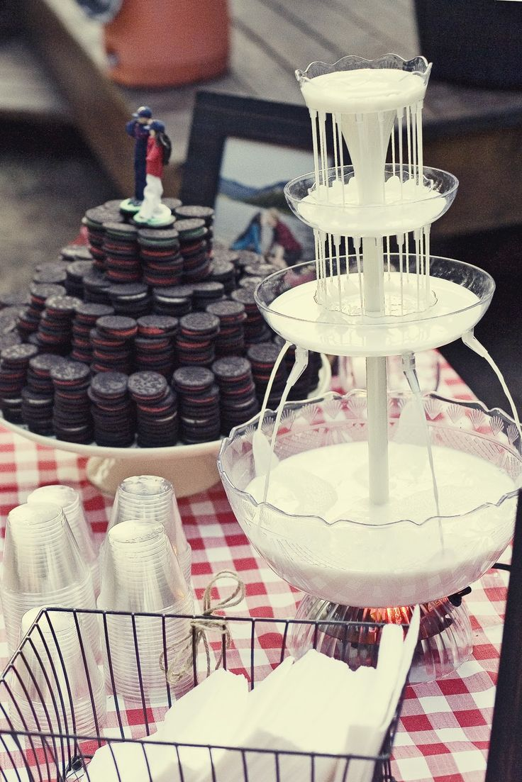 Our PERFECT wedding cake was a major hit! Yes, that's a milk fountain!