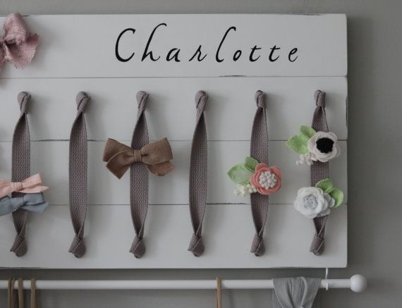 XL Personalized Hair Bow Holder Headband Organizer  Turn you daughters bow collection into a work of art with this original, handmade organizer. Its the perfect way to both organize and display your bows and headbands beautifully in any nursery, girls room or bathroom. The grey ribbon allows for a simple, elegant place to clip all your bows and barrettes. Each wood plank is hand-cut, painted, distressed and sealed for a beautiful smooth finish. I hand select quality material and wood to…