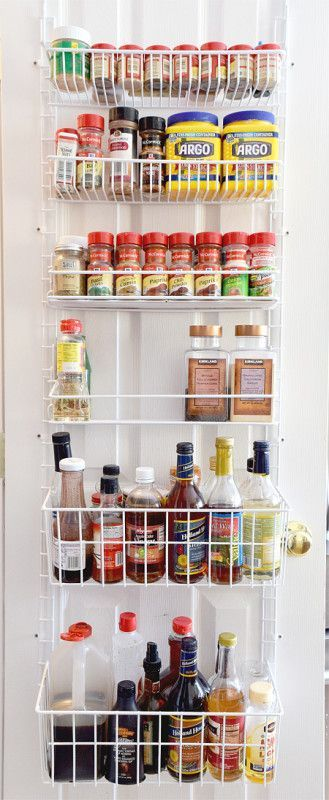 Small Pantry Organization Idea - Use baskets to hang on the back of the door. Great sauce and spice storage idea.