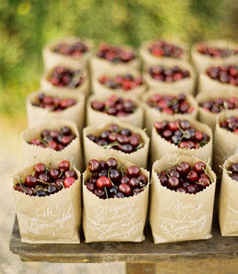 bags of cherries as summery favors - shot by jose villa - design*sponge #camillestyles