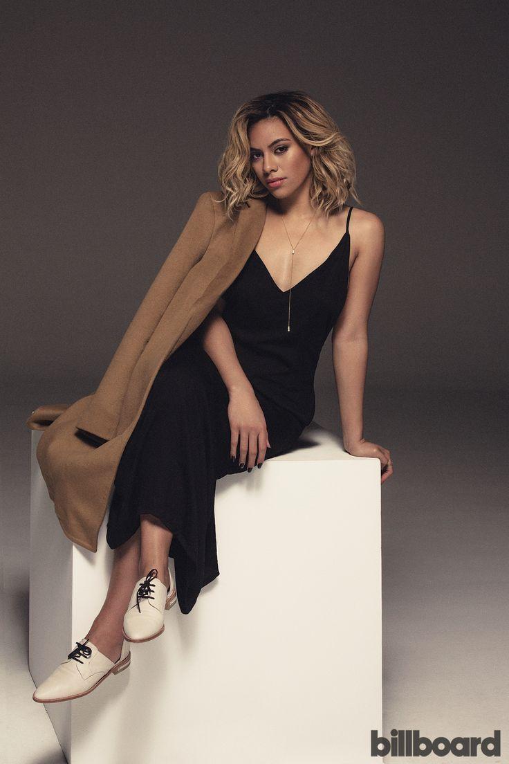 Dinah Jane Hansen wears a ThePerfext coat, Onia dress, Georg Jensen necklace and Freda Salvador shoes.
