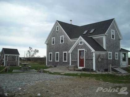 Located in the picturesque seaside village of Salmon River. This fully furnished Acadian style home has many renovations and upgrades, while still maintaining the tradfiotonal style of this type of h