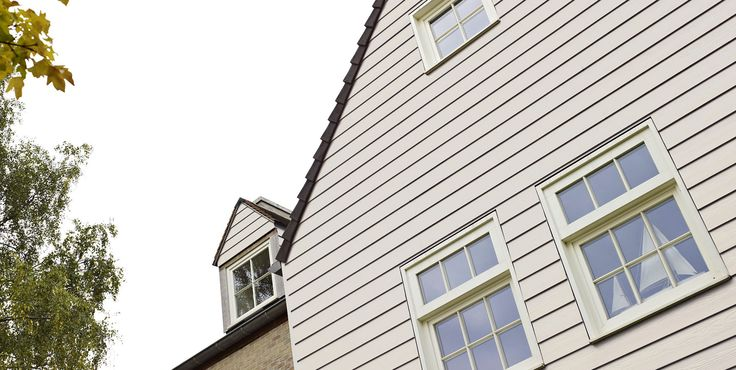 Fortex cladding (PVC) looks as good as wooden cladding on this  house front. Using PVC cladding takes away the maintenance required in regularly painting and sanding real wooden cladding.