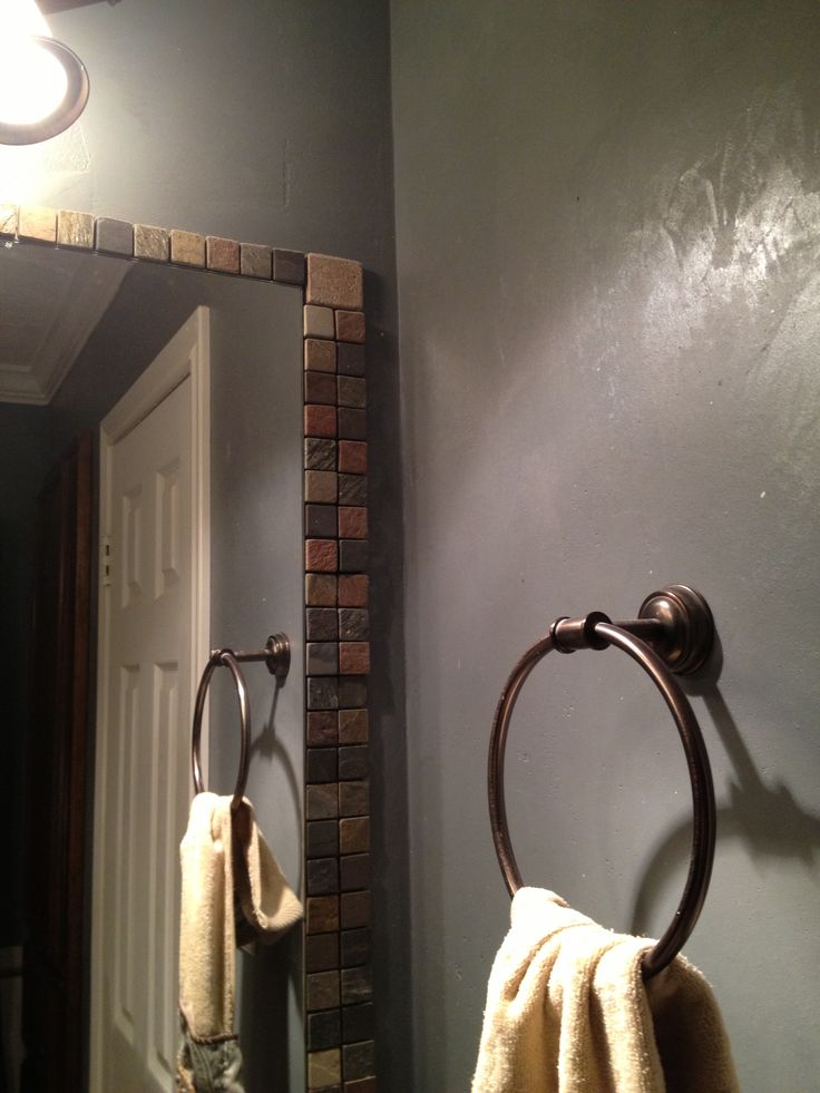 Tile frame around old bathroom mirror