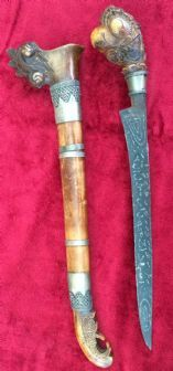 An interesting Indonesian dagger, carved wooden Parrot's head hilt, complete with original scabbard