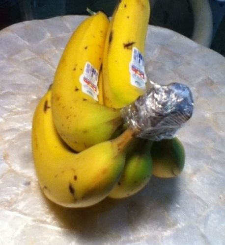Wrap the crown of a bunch of bananas with plastic wrap.They'll keep for 3-5 days longer than usual, which is especially helpful if you eat organic bananas. Bananas also produce more ethelyne gas than any other fruit, so keep them isolated on the counter.