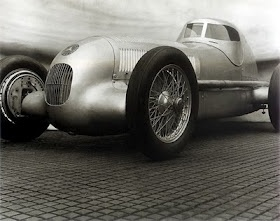 aerodynamically designed Mercedes open wheel race car with closed cockpit