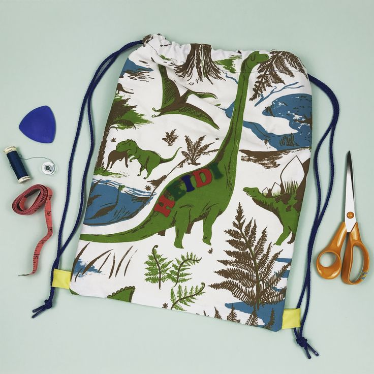 We made this P.E. kit bag for our dinosaur-obsessed daughter using ToDryFor's Drynosaurs tea towel (designed by Nicholas John Frith) and easy instructions found in issue #26 of @simplysewingmag