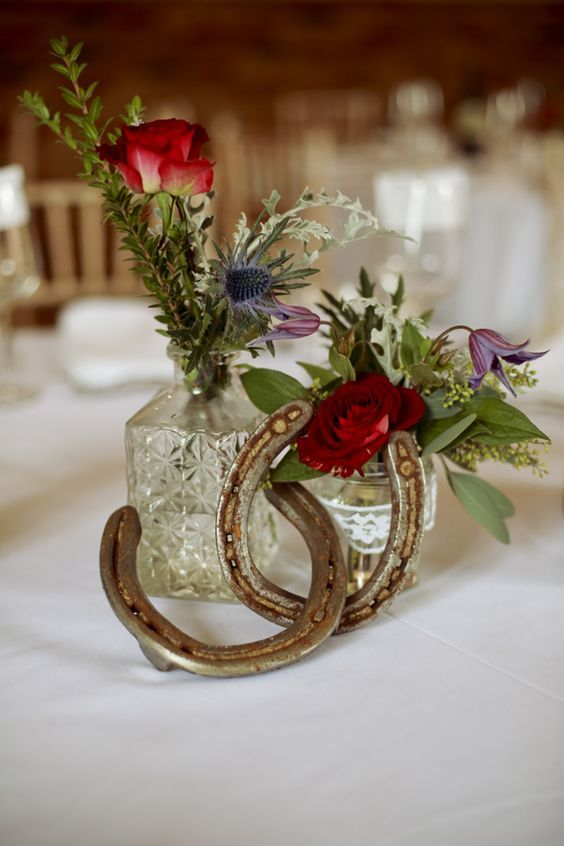 Rustic Red Barn Horseshoe Winter Wedding Centerpiece / http://www.deerpearlflowers.com/rustic-farm-wedding-horseshoe-ideas/