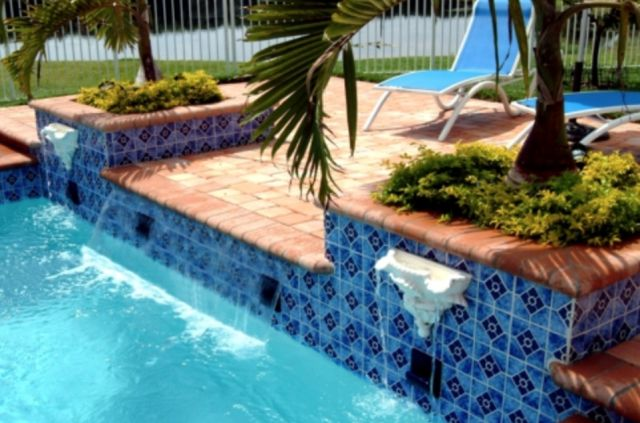 Custom Water Features for Pools: Fountains, Scuppers, Fire Features & More | Luxury Pools