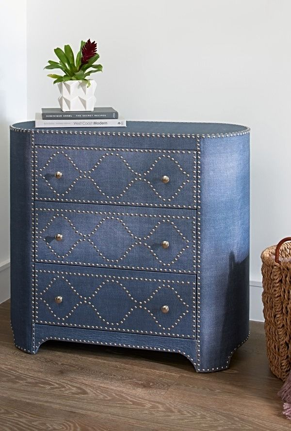 Please note the elliptical footprint of this Wedgewood Three-drawer Chest. That oval shaping you see makes this piece as fresh as the blue linen fabric that covers it. The curve adds interest and gives the chest a kind of classical, graceful bearing, while the denim-look fabric flips the classic-ness on its head and totally updates it for fun.