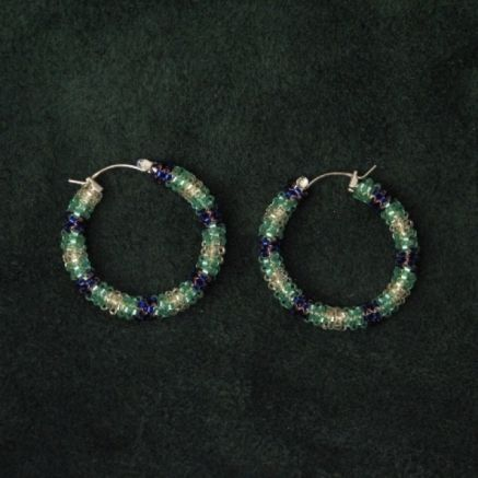 """Rock out these 1.5"""" purple/green/yellow peyote beaded hoops...make a statement! Made with silver lined miyuki delica beads hand stitched bead by bead. $40. By Sister Bear Designs."""