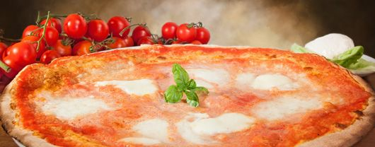 Traditional Italian Pizza with Buffalo Mozzarella (Pizza con Mozzarella di Bufala) | Enjoy this authentic Italian recipe from our kitchen to yours. Buon Appetito!