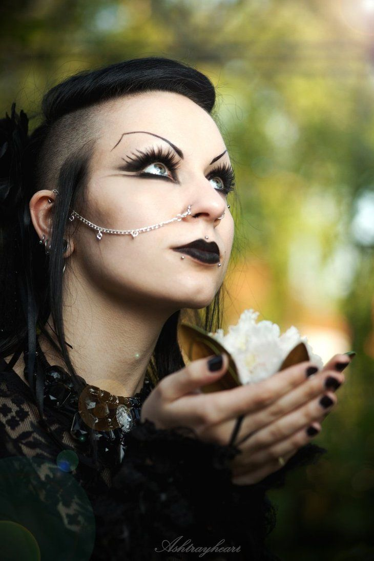 Gothic makeup- not a fan of the eyebrows but I like the nose piercing connecting to the ear