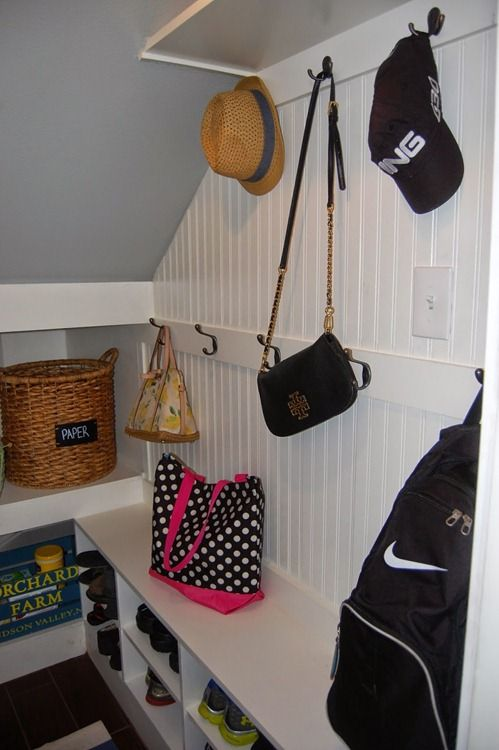 Turn closet under stairs into mudroom