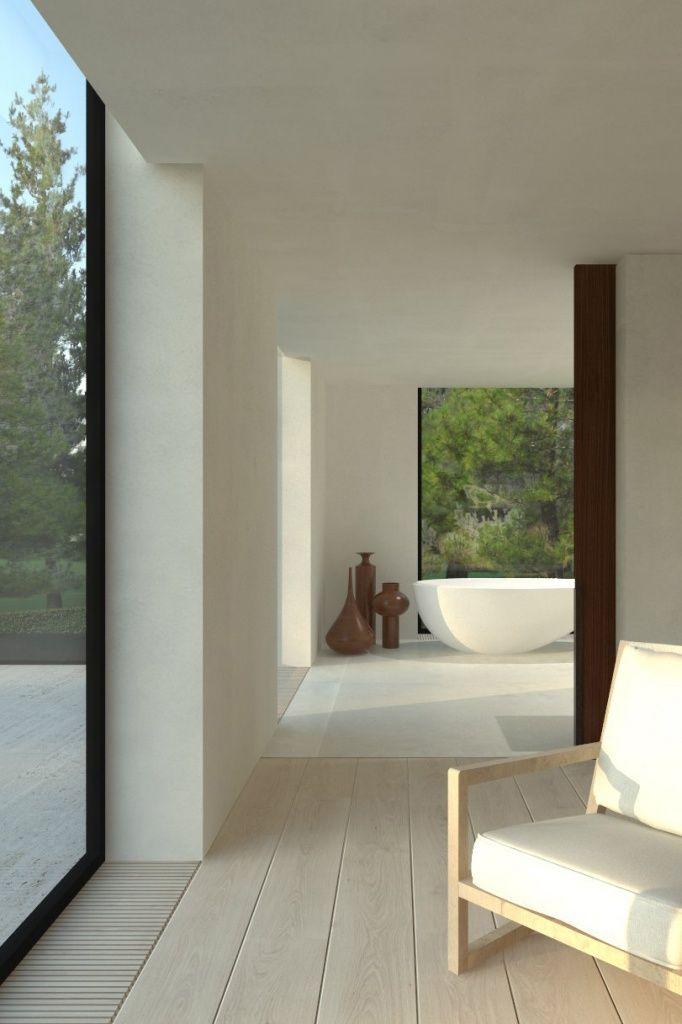 Eenvoudige lijnen, alu ramen, houten vloer. Spatie voor indirect licht en / of gordijn