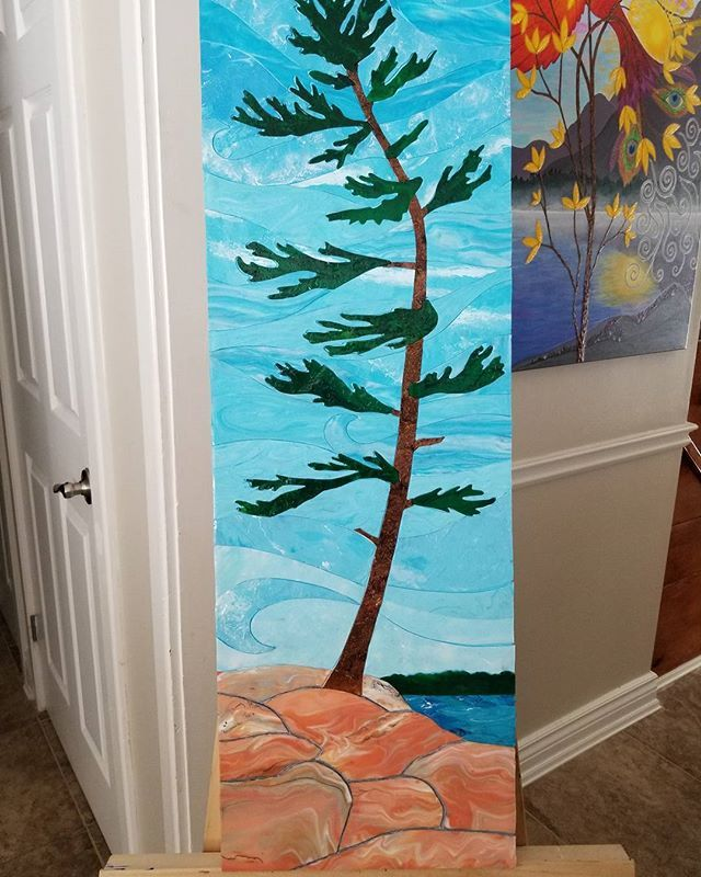 """My newest piece, with only a few minor finishing touches remaining. 12"""" × 36"""". This took a while with all the stages and planning of it. Meant to mimic stained glass. For the upcoming  spring art show in Muskoka. . . . #muskokaartist #fineart #acrylicskins #acrylicpainting #stainedglass #muskoka #windy #pine #canadianshield #canadianartist #pouredpainting #nature #beauty"""