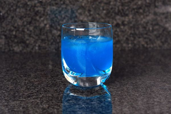 Blue Kamikaze: 1 oz vodka, 1 oz blue curaçao, 1 oz lime juice. Combine over ice, shake well, and pour in an ice-filled lowball glass.