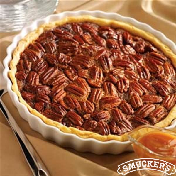 This Caramel Pecan Pie Recipe from Smucker's® is a delicious way to end your Thanksgiving meal!
