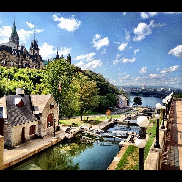 Parliament Hill overlooking the Rideau Canal locks, Ottawa. For more information on capital sites and Canadian heritage visit http://www.ottawatourism.ca/en/visitors/what-to-do/capital-heritage