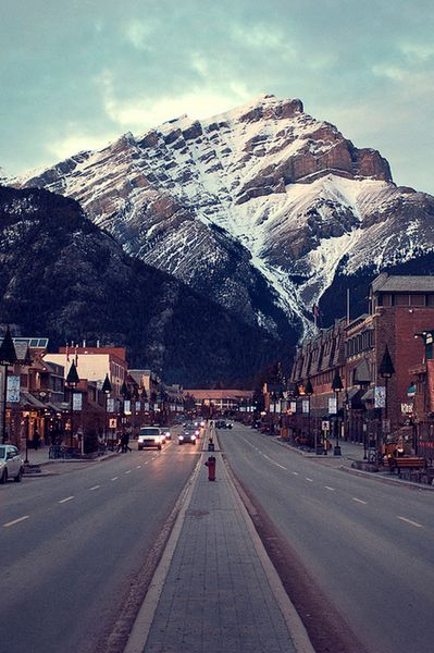 Dwarfed by nature...   This is Banff town in Banff National Park in Alberta, Canada. ...been there!!
