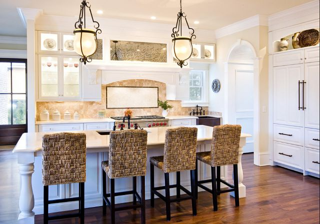 Countertops are Crema Marfil and backsplash is emperadora light. Light fixtures are by Charleston Lighting, Chas. Sc Pendant bell jar Merida.Floor is a naturally finished walnut.