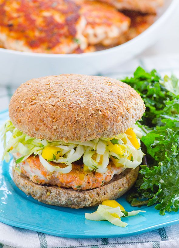 Delicious salmon burgers recipe with red lentils to make them more affordable and nutritious. Topped with delicious slaw. My kids licked the plates.   ifoodreal.com