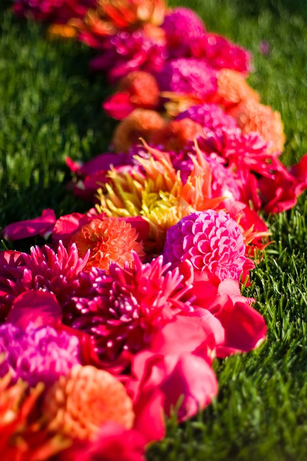 Bright Pink, Orange and pop of yellow, aisle flowers.