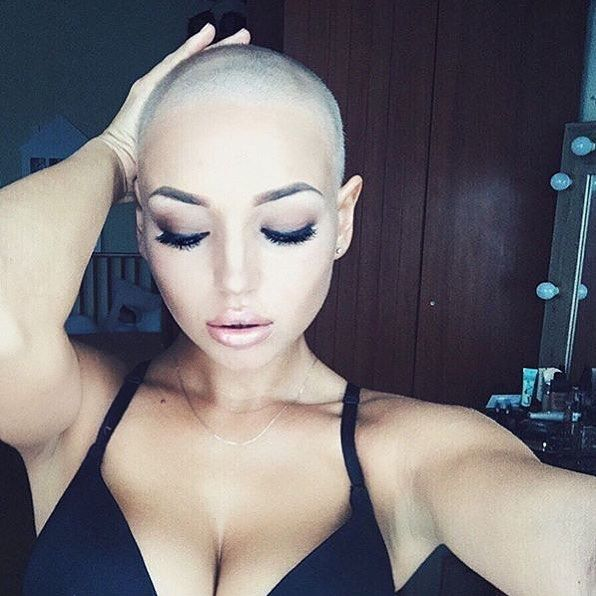 Shaved bald women wrestlers