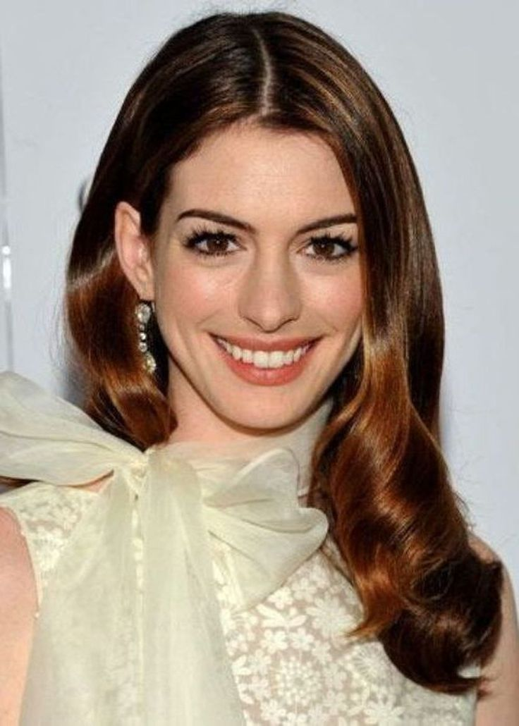 Anne Hathaway deep drown auburn hair  ~~ 21 most famous celebrity redheads to inspire your next hairstyle