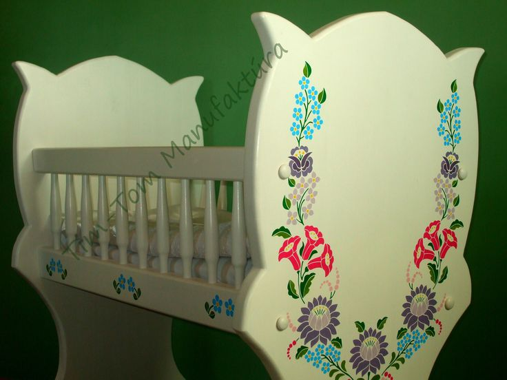 "Just finished the latest cradle. Among them their is one of the ""Tulip"" fancy name. Outside the special shape the decoration on it makes it unique. The decoration is used in the traditional Hungarian motifs, but their design is made by us. So it will be different for each pattern. The same pattern is not used once again, so every cradle is unique, ""one valuable piece"""