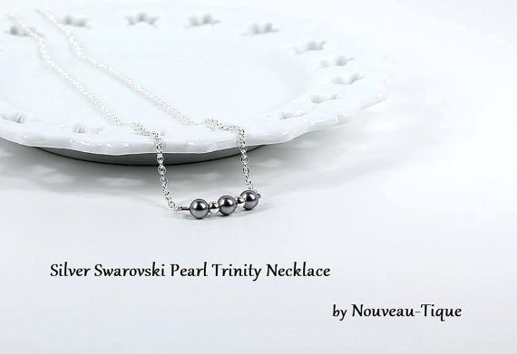 """This minimal beautiful and charming necklace was created with three perfect silver Swarovski pearls on a sterling silver filled chain with a lobster clasp. A modern pearl necklace that goes with everything from a dress to jeans and a t-shirt. Makes a beautiful layering necklace. This necklace was designed by me for a special gift bag for the wardrobe stylist for the TV series """"Jane the Virgin"""" coordinated by The Artisan Group, and was chosen by the stylist and worn on Season 2 Episode 17."""