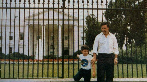 Pablo Escobar and his son stand in front of The White House in the early 1980s.
