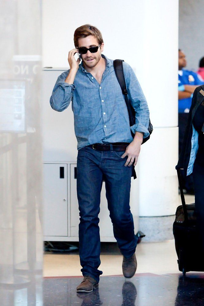At the airport, actor Jake Gyllenhaal keeps his style simple, wearing double denim and a pair of brown chukka boots.