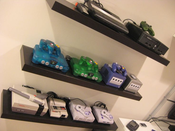 Gaming Consoles on floating shelves - game room via Backward Compatible Video Game Blog