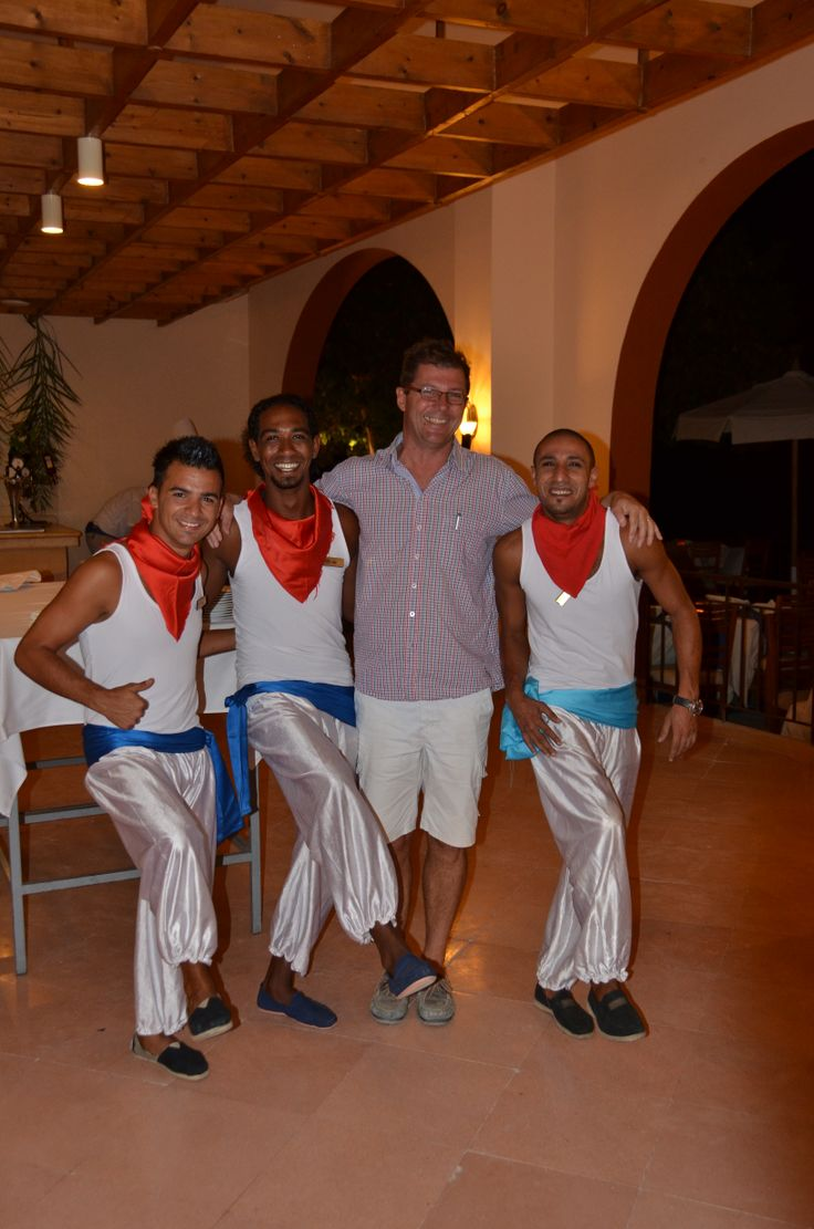 The person with the traditional Greek outfit is Christophe.