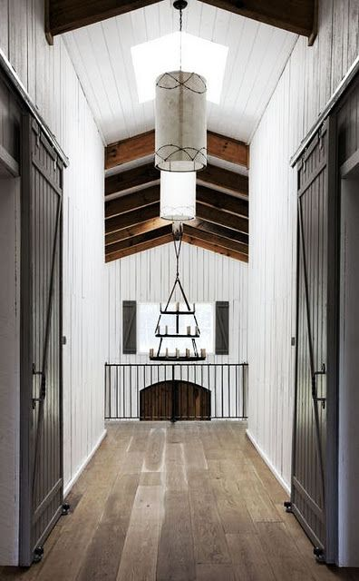 neutral painted walls, timber floors, sliding barn style interior doors