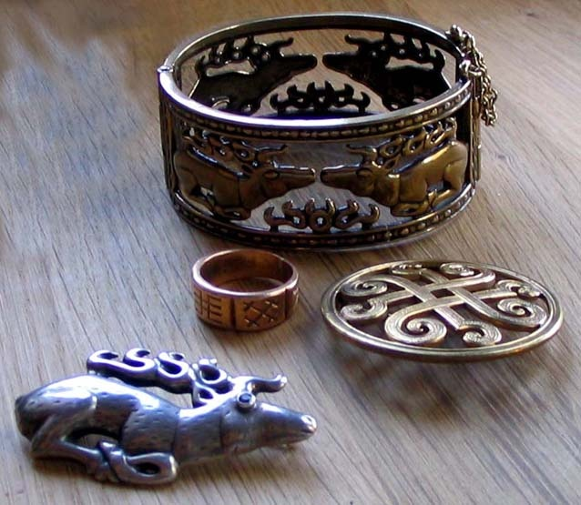 Kalevala Koru WANT THAT BRACLET!! I have a pin like the one on the right of the picture.