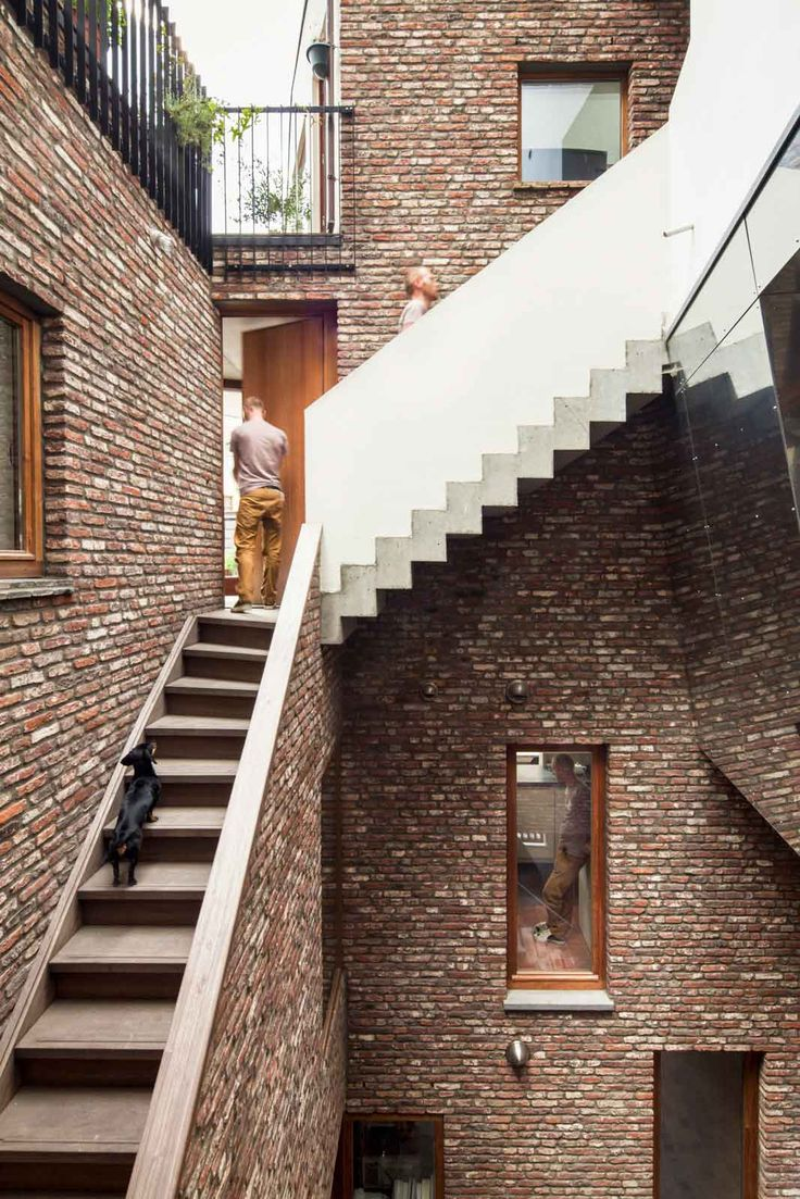 Gewad in Ghent, Belgium by Atelier Vens Vanbelle   brick, concrete stairs, timber window joinery and powdercoated steel railings