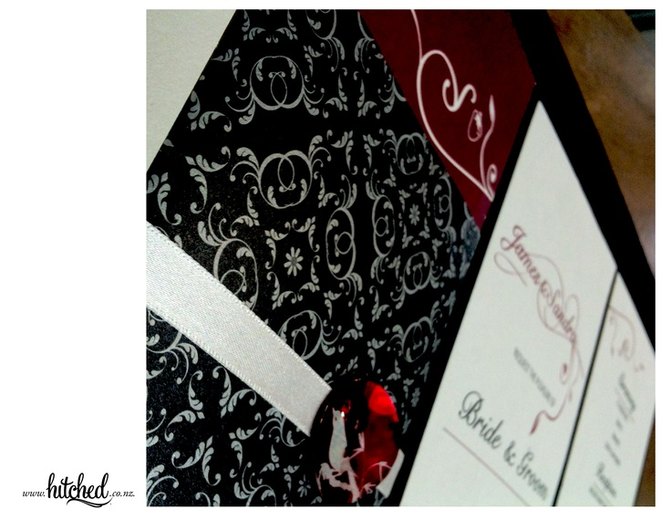 www.hitched.co.nz - rich red with deep charcoal and a splash of ivory ribbon.