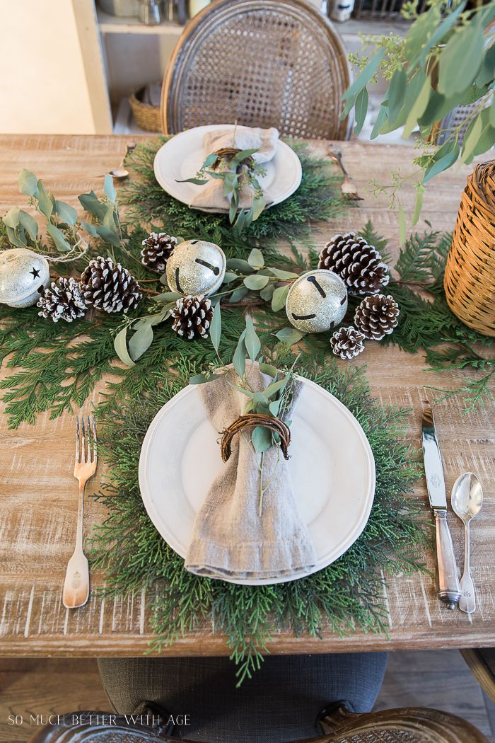 French Christmas Dining Room With Evergreen Pinecones And Banners Christmas Table Settings Natural Christmas Decor Christmas Table Centerpieces