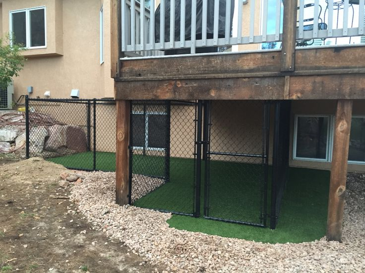"Our dog's ""den"" under the deck with dog turf. A ramp from the deck leading into the den is being constructed. There will also be a chain link top with optional waterproof canvas lid. Our little Toy Fox Terrier loves it!"