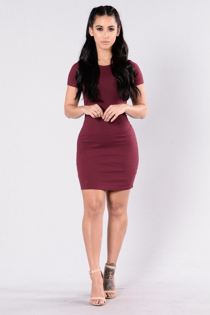 - Available in Burgundy, Dark Mocha, Dolphin Grey, and Olive - Ribbed Dress - Fitted - Scoop Neckline - Short Sleeve - 57% Cotton 38% Polyester 5% Spandex
