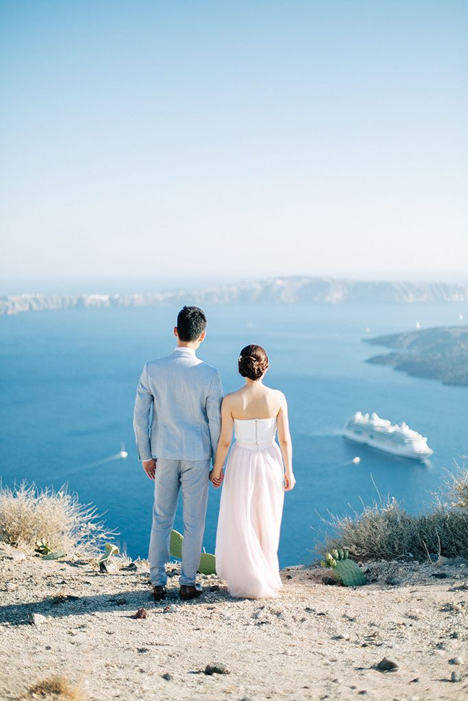 Let's bring summer back today! With its soft blues, endless skies and the sweetest of aegean light. Any takers? #realwedding #endlessblue #weddinginSantorini