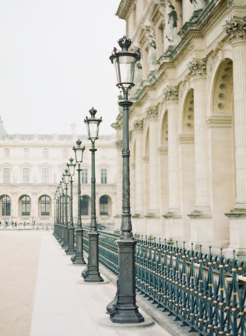 Street lamps lining the Louvre Museum in Paris. Photography by Heidi Lau.