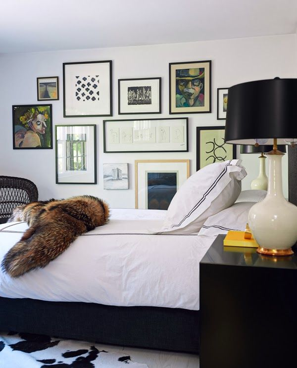 Mimosa Lane: Interiors || Patrick Mele - bedroom decor, interior design, white hotel bedding with black piping, fur throw, gallery wall, white lamp with black shade, modern, sexy, masculine