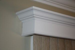 Crown molding cornice over vertical blinds.