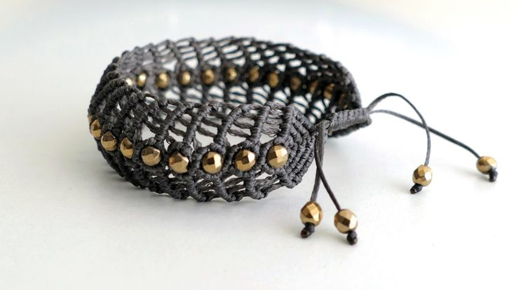 Handmade grey macrame bracelet with a series of gold plated Hematite -Price:54€