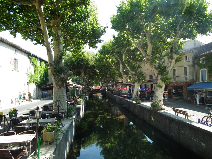 Goudargues (Little Venice) Ardeche, France  I sat up on the right hand side behind the red umbrella - love this place