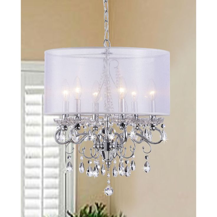 Create an elegant ambience in your home with this crystal chandelier with shade. Featuring a sophisticated white fabric shade, this six-light fixture will make a stunning addition to any room. Gleaming chrome plating completes this fixture.